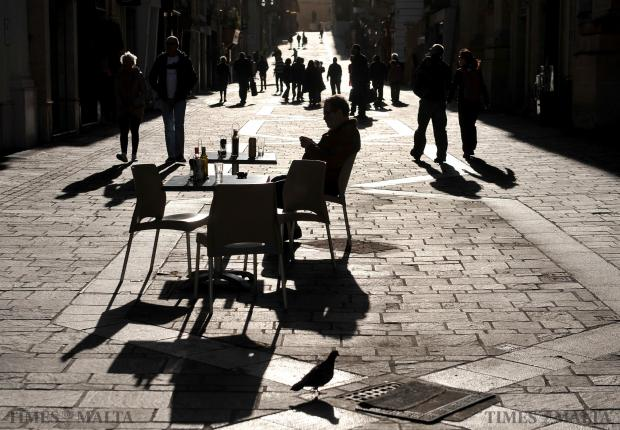 A man enjoys a drink in Merchant Street, Valletta on February 5. Photo: Chris Sant Fournier