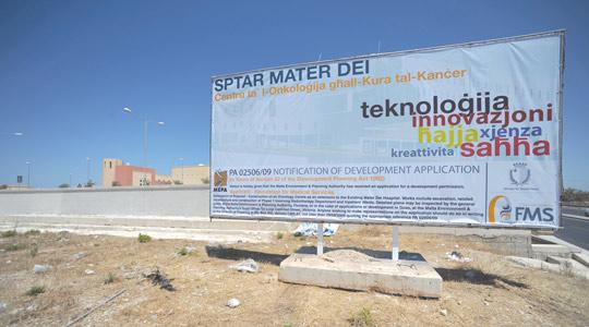 The billboard summarises the government's project to build a €40 million cancer centre next door to Mater Dei Hospital.