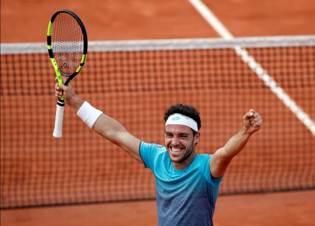 Marco Cecchinato celebrates his victory over David Goffin at the French Open.