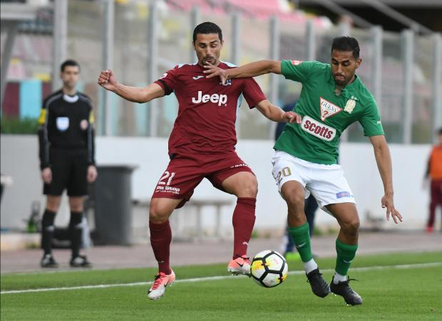 Roderick Briffa (left) of Gżira United and Floriana's Tiago Galvao in contention for the ball. Photo: Matthew Mirabelli
