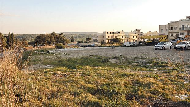 The plot of land at the heart of this controversy, next to Valyou Supermarket in Mellieħa. Photo: Chris Sant Fournier