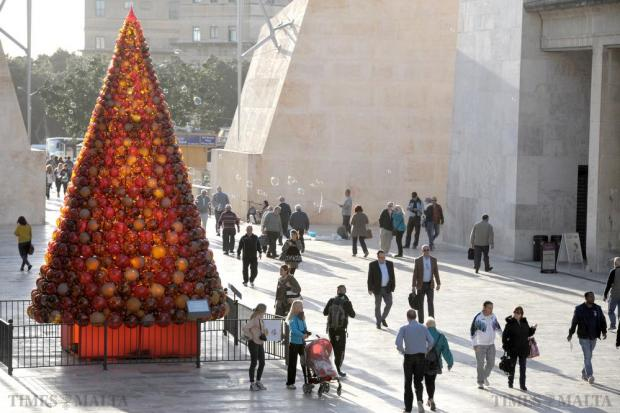 A Christmas tree made of thousands of glass baubles, delicately put together by Mdina Glass, contrasts sharply with the stone hues of City Gate in Valletta as the capital starts to take on the colours of Christmas on November 30. Photo: Matthew Mirabelli