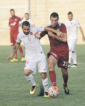 Running duel... Valletta's Leandro Aguirre tries to move clear of Jacob Borg, of Gżira United. Photo: Chris Sant Fournier