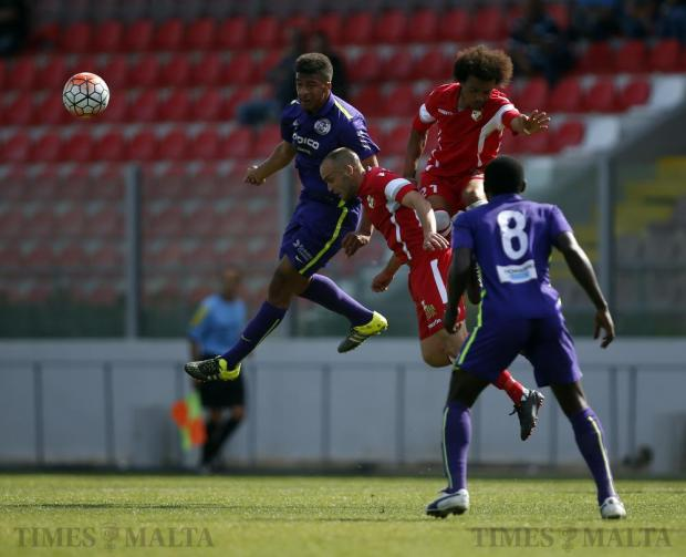 Kyian Nwoko (left) of St Andrew's wins an aerial challenge with David Fenech (centre) and Ennio Hamut-Enya of Naxxar Lions during their Premier League football match at the Hibernians Stadium in Corradino on April 23. Photo: Darrin Zammit Lupi