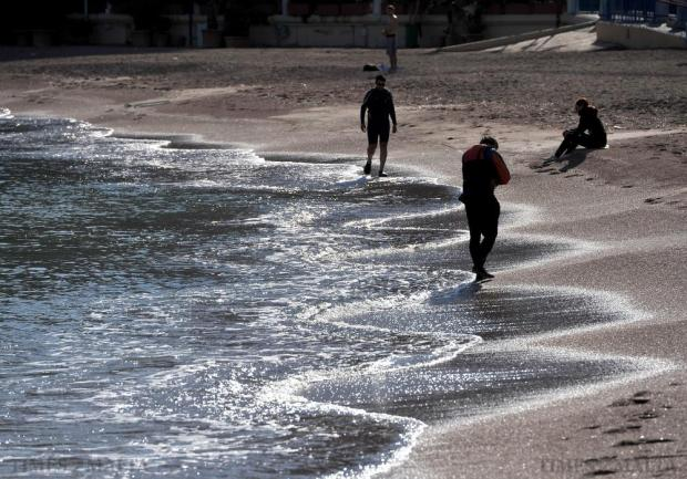 The mild December weather tempts people to the beach at St George's Bay on December 19. Photo: Chris Sant Fournier