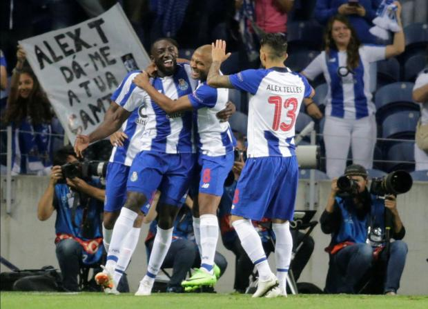 FC Porto's Moussa Marega celebrates scoring their first goal with teammates.