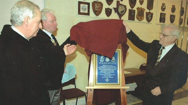 Heritage Malta chairman Mario Tabone, Davis Woodcock and President Eddie Fenech Adami unveiling the plaque in February 2008.