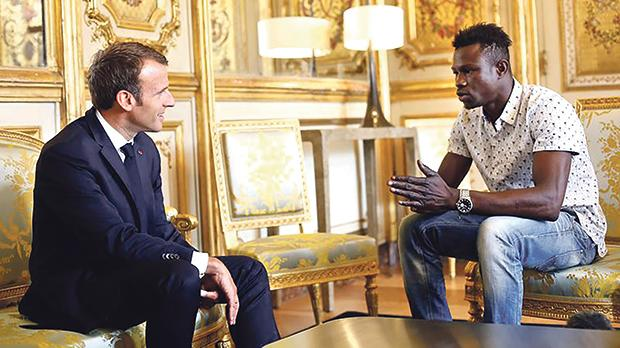 French President Emmanuel Macron gave citizenship to Mamoudou Gassama following his daring rescue of a toddler in Paris last May.
