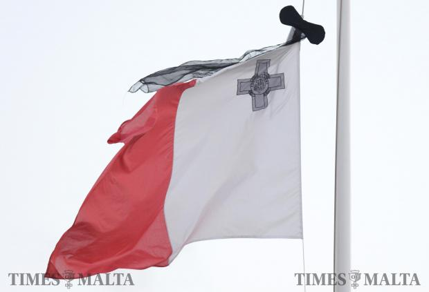 A flag flies at half-mast over Gharghur as the funeral of murdered blogger Daphne Caruana Galizia takes place at Mosta Dome on November 3. Photo: Matthew Mirabelli