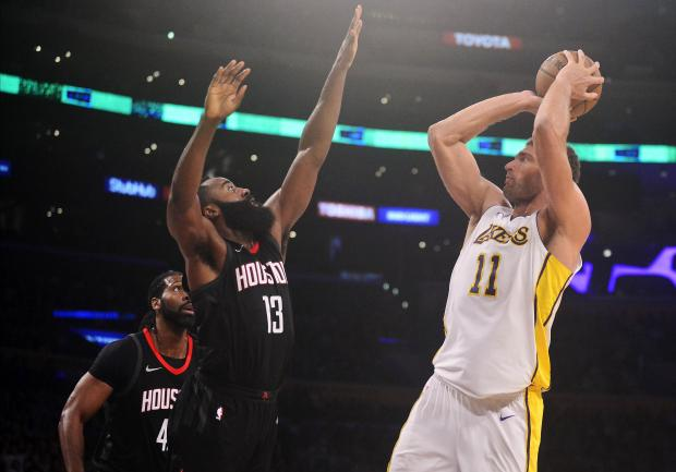 Los Angeles Lakers center Brook Lopez (11) shoots against Houston Rockets guard James Harden (13) during the second half at Staples Center. Photo: Gary A. Vasquez-USA TODAY Sports