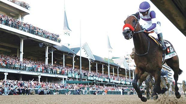 Nyquist charges to victory at the Kentucky Derby in Louisville.