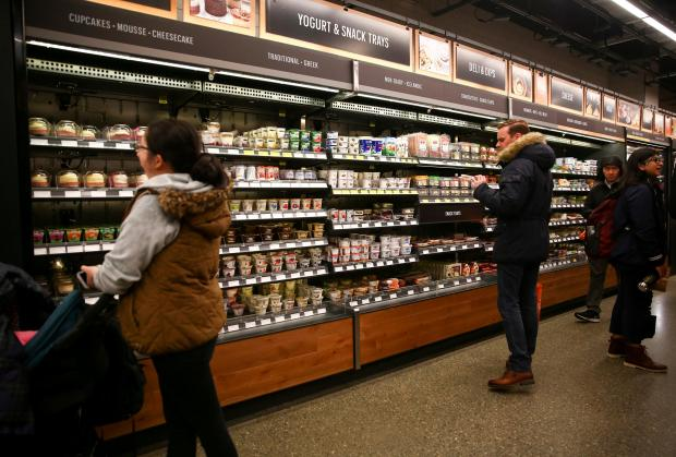 Customers browse the yogurt and deli sections in the new Amazon Go store at Amazon's Seattle headquarters in Seattle.