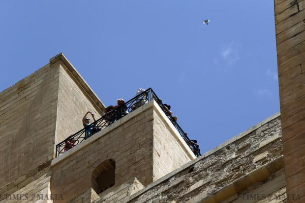 Tourists at the Upper Barrakka Gardens in Valletta photograph the view on June 24. Photo: Darrin Zammit Lupi