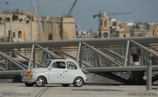 The owner of a Fiat 500 drives along Dock 1 in Cospicua during an open day showcasing old and new Fiat 500's on September 6. Photo: Matthew Mirabelli
