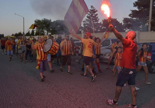 A Birkirkara supporter on his way to watch the UEFA Europa League qualifier against West Ham lights up a flare outside the National Stadium in Ta'Qali on July 23. Photo: Mark Zammit Cordina