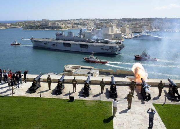 HMS Ocean sails out of the Grand Harbour on March 12, after what was probably her last visit to the island prior to being decommissioned in a year's time. The departure was marked by a gun salute from the Upper Barrakka, in Valletta. Photo: Mark Zammit Cordina