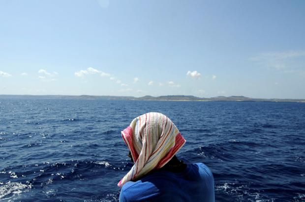 A woman aboard the Aquarius looks out as the ship approaches Malta. Photo: Reuters