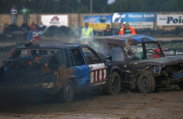 Drivers take part in a demolition derby organised by the Malta Motor Sports Association to raise funds for charity in Ta' Qali on December 21. The drivers have one ultimate aim - that their vehicle, or what's left of it, remains the only one standing. Photo: Darrin Zammit Lupi