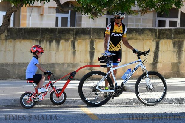 A man and child participate in the national bike ride organised by Transport Malta as part of the European Mobility week, on September 21. Photo: Jonathan Borg