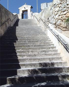 The first flight of 26 steps leading down to the underground chapel crypt.