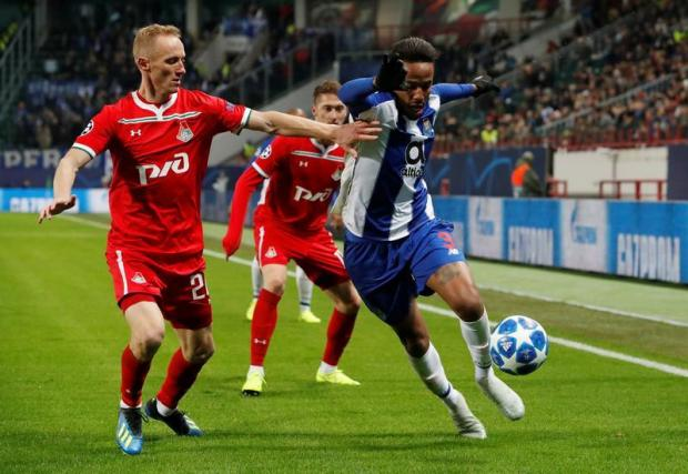 Real Madrid secure 50 million-euro Militao from Porto. FC Porto s Eder  Militao in action with Lokomotiv Moscow s Vladislav ... d8a38394ef20e