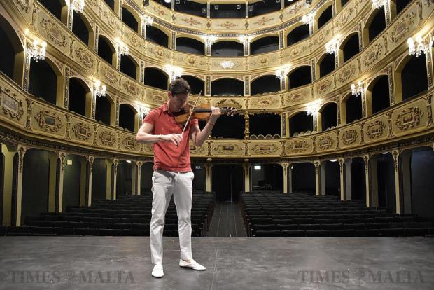 Acclaimed British violinist Charlie Siem poses for a picture on the Manoel Theatre stage in Valletta on April 24. Photo: Mark Zammit Cordina