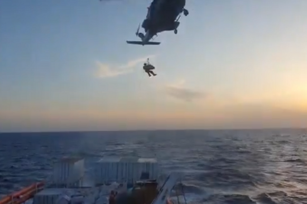 Watch - AFM helicopter evacuates pregnant migrant from rescue ship