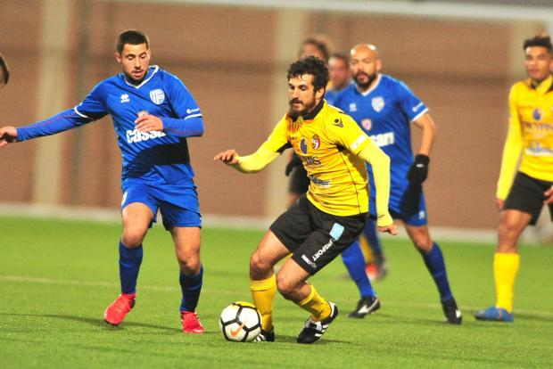 Antonio Rozzi (right) of Qormi trying to move past Tarxien Rainbows' Gabriel Aquilina. Photo: Stephen Gatt