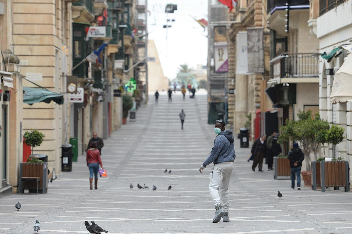 It was always quite surreal heading to Valletta during the first few weeks of the COVID-19 outbreak to witness streets that are normally so packed and lively being totally deserted and isolated with just a few people wondering about. I would head there nearly on a daily basis to try to get different shots and, each day, you would encounter something different. Photo: Matthew Mirabelli
