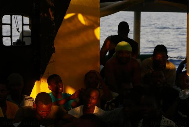 Migrants take part in an impromptu prayer meeting at the stern of the Medecins san Frontiere (MSF) rescue ship Bourbon Argos somewhere between Libya and Sicily at sunset on August 8. The 241 mostly West African migrants on the ship were taken to Trapani in Sicily. Photo: Darrin Zammit Lupi