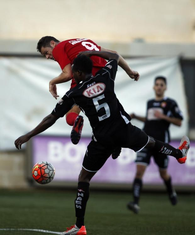 Pembroke's Gibson Bardsley heads the ball after pulling clear of Qormi's Noah Ojuola during their Premier League football match at the Tedesco Stadium in Hamrun on November 21. Photo: Darrin Zammit Lupi