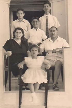 The author (centre) with his family at their summer residence in Buġibba in the summer of 1956.
