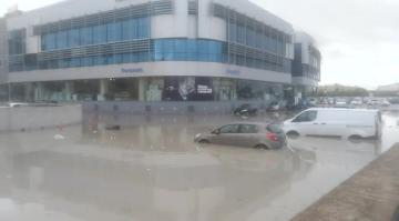 Roads, cars flooded as sudden downpour causes chaos