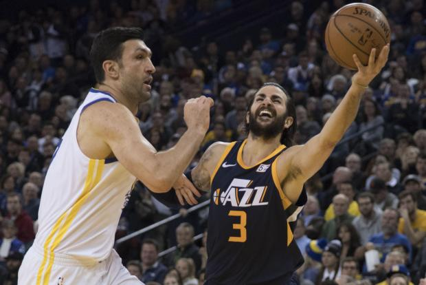 Utah Jazz guard Ricky Rubio (3) shoots the basketball against Golden State Warriors center Zaza Pachulia (27) during the third quarter at Oracle Arena. The Warriors defeated the Jazz 126-101. Photo: Kyle Terada-USA TODAY Sports