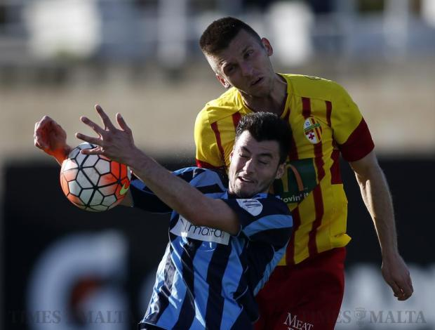 Sliema Wanderers striker Jean Paul Farrugia (front) is outjumped by Birkirkara defender Christian Bubalovic during their Premier League football match at the Hibs Stadium in Corradino on March 12. Photo: Darrin Zammit Lupi