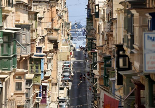 The cruise liner MSC Poesia is seen from St Paul's Street in Valletta as she leaves Grand Harbour on August 17. Photo: Chris Sant Fournier