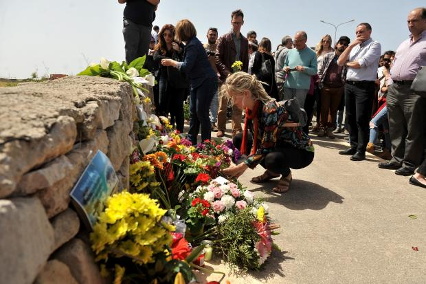 Mourners lay flowers on the spot where the migrant was shot dead. Photo: ChrisSantFournier