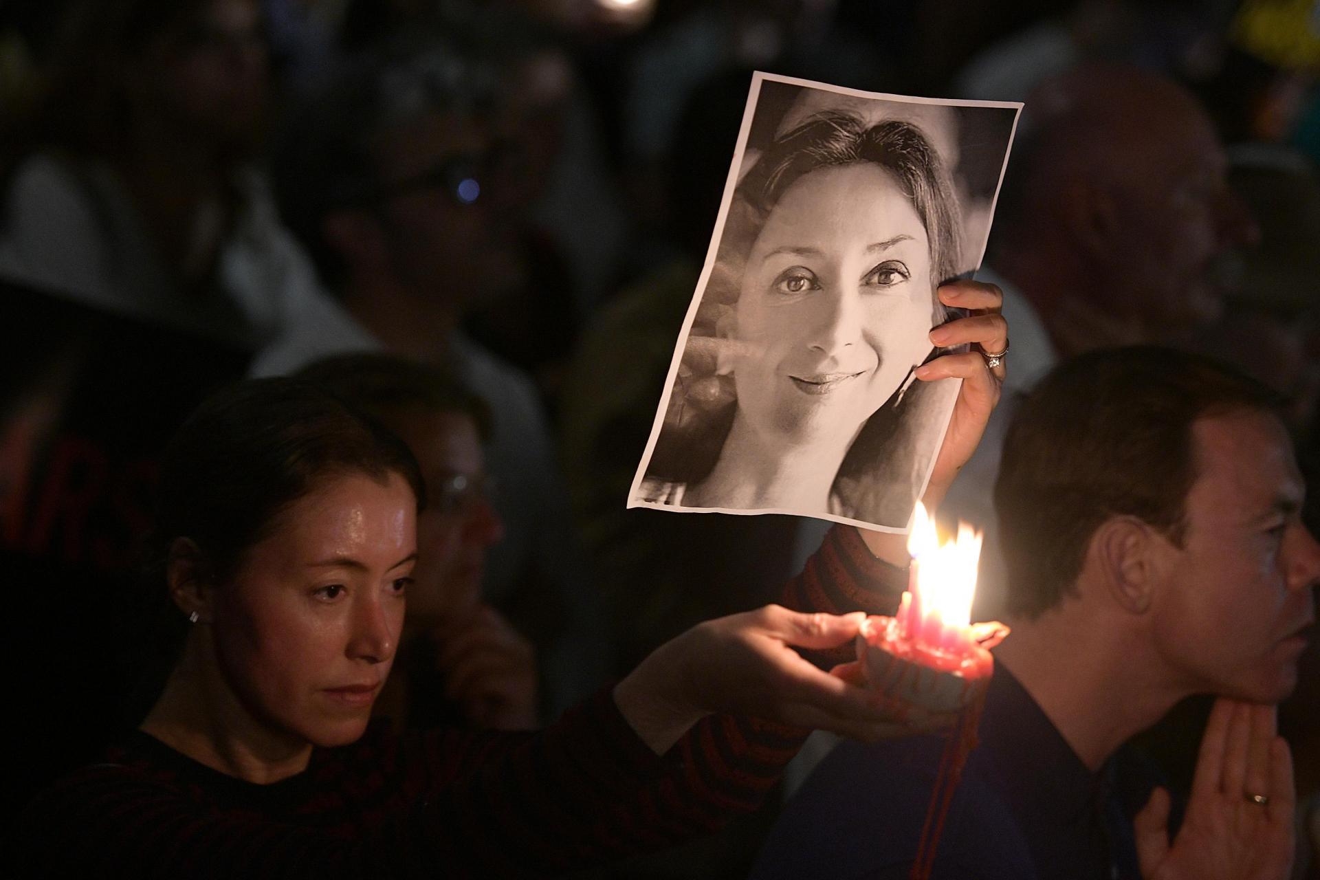 Daphne Caruana Galizia's image at a vigil. Picture: Matthew Mirabelli