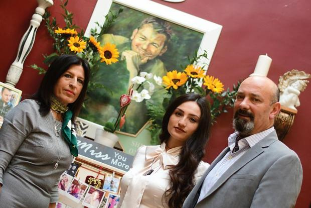 Adoring Drew… Sharon, Bobbie and Kenneth Abela have a special shrine for their hero at home. Photo: Jonathan Borg