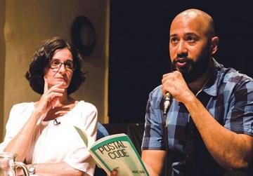 Author Marc Nair reading during a pre-festival event held on Tuesday. On stage with him is sociologist Anna Zammit. Photo: Virginia Monteforte