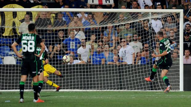 Sassuolo's Domenico Berardi scores their first goal from the penalty spot.