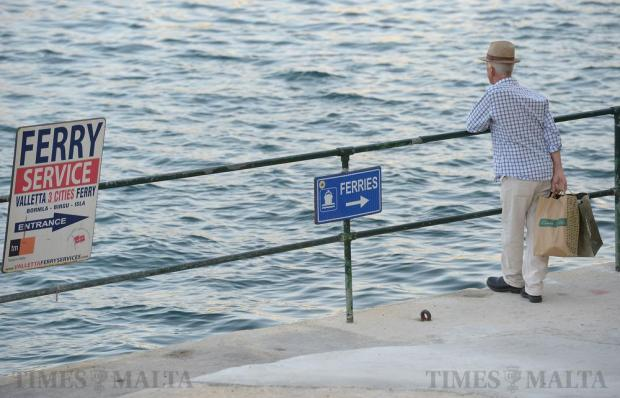 A man waits for the ferry from Valletta to the Three Cities on August 11. Photo: Matthew Mirabelli