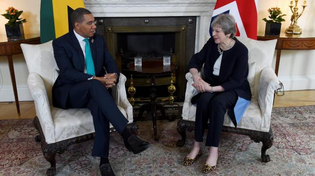 Britain's Prime Minister Theresa May meets Jamaica's Prime Minister Andrew Holness at 10 Downing Street, in London