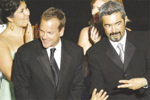 Director Jon Cassar (right) and actor Kiefer Sutherland gesture on stage during their award for outstanding drama series 24, at the 58th annual Primetime Emmy Awards at the Shrine Auditorium in Los Angeles, on Sunday.