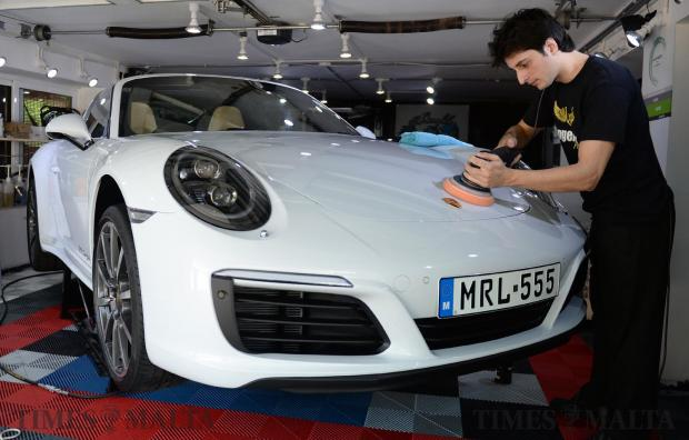 Ryan Aquilina cleans a supercar at his workshop in Mellieha on June 3. Ryan started the business eight years ago and specialises in cleaning high end sports cars. Photo: Matthew Mirabelli