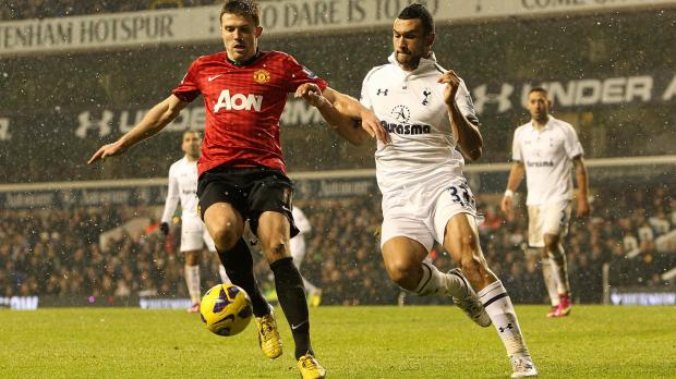Manchester United's Michael Carrick (left) and Tottenham Hotspur's Steven Caulker (right) battle for the ball during the Barclays Premier League match at White Hart Lane, London. Photo: Sean Dempsey, PA Wire
