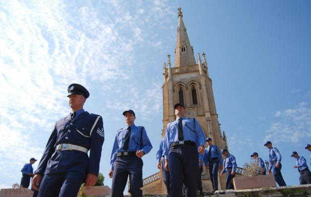 Police march from Our Lady of Sorrows chapel during a commemorative service in memory of deceased police officers at the Addolorata Cemetery on July 5. Photo: Mark Zammit Cordina
