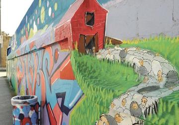 140m of Don Quixote street art brightens access to Naxxar school