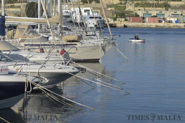 A fisherman in a small boat fishes in the marina in Ta' Xbiex on February 22. Photo: Mark Zammit Cordina
