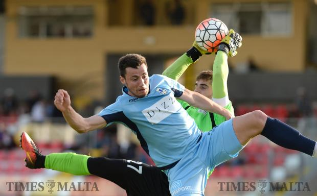Sliema's Jean Paul Farrugia and Pembroke goal keeper Matthew Calleja Cremona clash during their BOV premiership match at the Hibernians Stadium in Kordin on April 29. Photo: Matthew Mirabelli